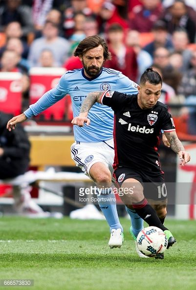 New York City FC midfielder Andrea Pirlo (21) chases after D.C. United midfielder Luciano Acosta (10) during a MLS game between D.C. United and New York City FC on April 08, 2017, at RFK Stadium, in Washington DC. DC United defeated New York City FC 2-1. #DCUnited #DCU #WeAreUnited