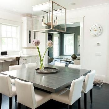 dining room gray. chic dining room features a glass and metal lantern illuminating an oversized gray square table lined with eight white chairs situated across n