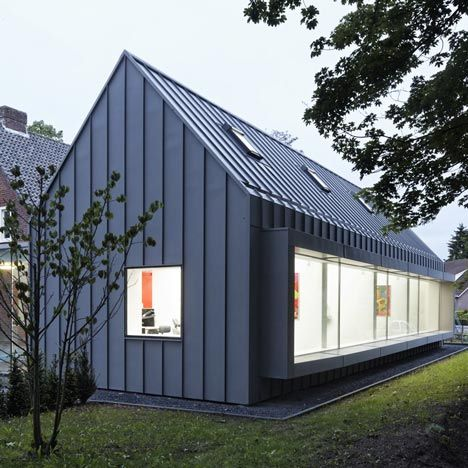 Dutch studio Shift has converted a suburban house in the south of the Netherlands and turned it into a dental surgery with a new zinc-clad wing!