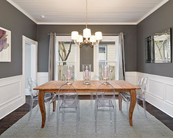 Benjamin Moore Kendall Charcoal paint color on the walls combined with white wainscoting in the formal dining room.