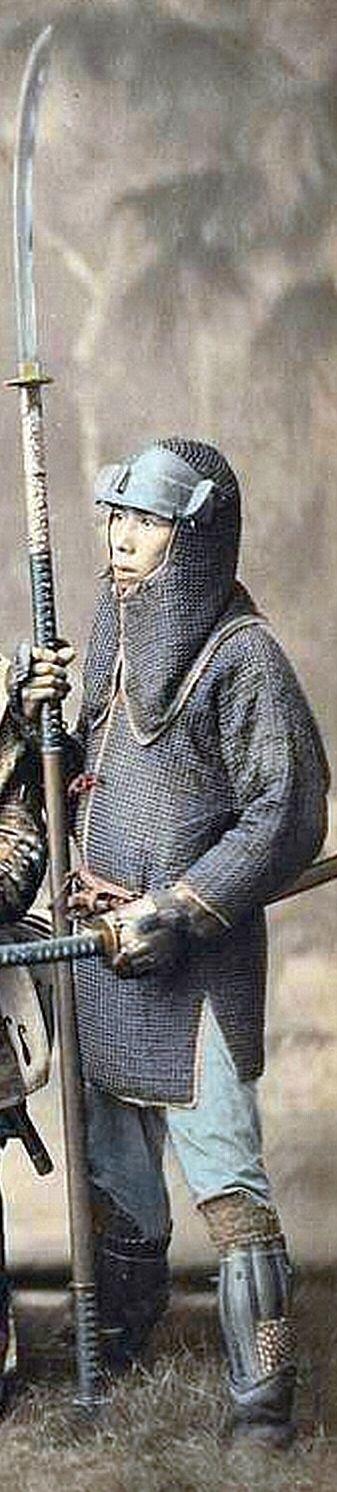 Samurai holding a naginata and wearing a hachi gane (fore head protector) and kusari katabira (chain armor jacket).