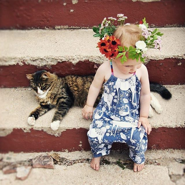 ~ Furry Friend ~ A little one playing in her Barefoot Romper, her feline friend by her side.  So much cuteness. Not to mention that flower crown 🌸🙌🏻 📷 @littleroosterhandmade