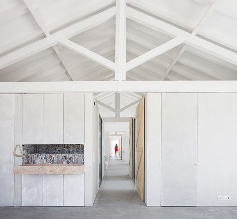 summer home from an old stable. sliding 'barn' doors in every room + white ceiling = lovely clean, cool light. Sítio da Lezíria by Atelier Data
