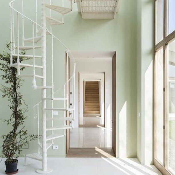 A suburban #villa near Pavia | The sequence of conjoined rooms renews the ancient #enfilade theme creating a new #perspective view in the house  #stairs