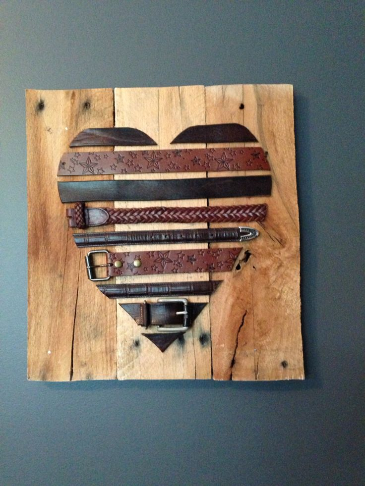 Leather belts and pallets. 3 year wedding anniversary traditional gift is leather so I made this piece of wall art for my wife as part of her gift.