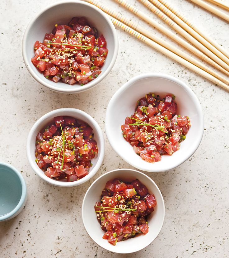 Don't shy away from preparing raw fish. Look for sushi-grade tuna at a fish market, work quickly, and this dish will be a success! The Asian flavors of ginger, soy, chile and lime juice highlight t...