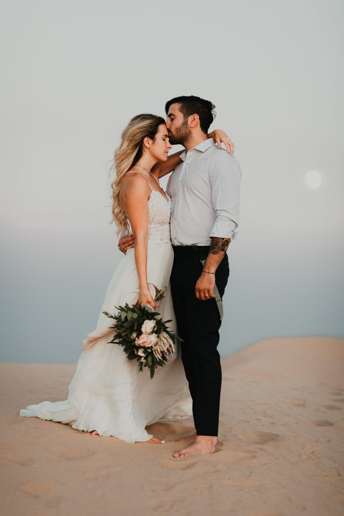 We're vibing with the romantic forehead kisses and a moody desert backdrop from this sweet couple's wedding | Image by Cody and Allison Photography  #wedding #weddinginspiration #californiawedding #retrowedding #desertwedding #bride #bridalstyle #bridalinspiration #groom #groominspiration #groomstyle #weddingportrait #coupleportrait #bouquet #bridalbouquet #weddingbouquet