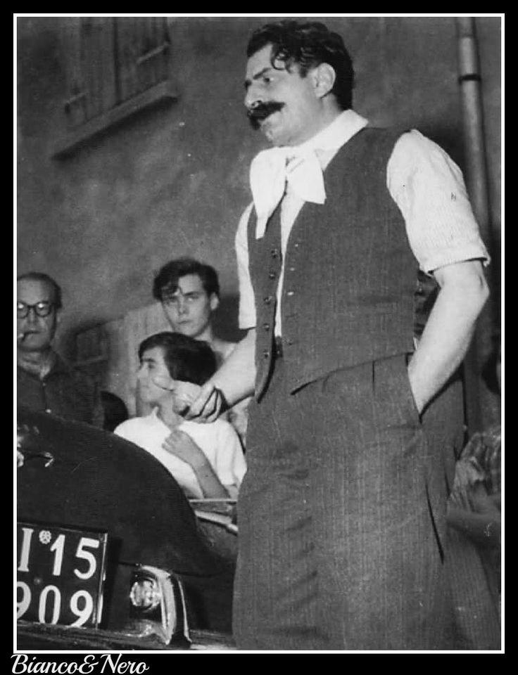 """di-biancoenero: """"Guareschi vestito come Peppone sul set di Don Camillo, 1952. 'A Noi e concesso soltanto sognare.  Sognare E La Necessità Più urgente Perché La nostra vita è Al di là del reticolato, e oltre il reticolato CI PUÒ Portare Solamente il ..."""