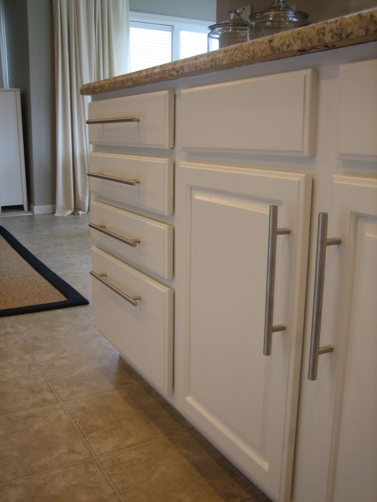 Another example of updated stock oak kitchen cabinets with new hardware and countertops!  What a difference a weekend can make!