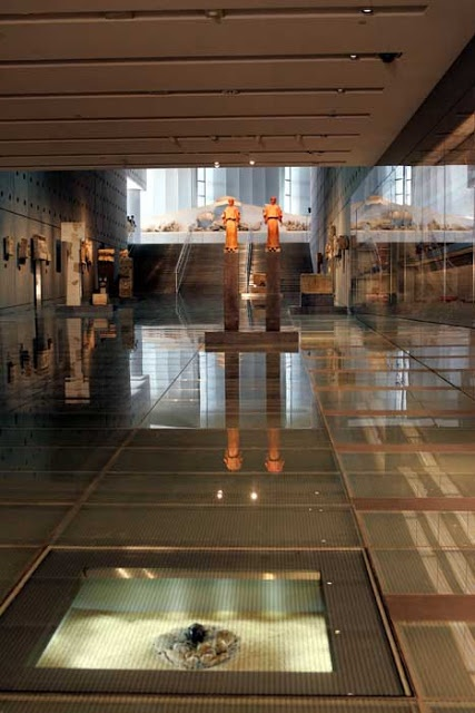 First level of new Acropolis museum. Exhibits artifacts found on the foothills of Acropolis.