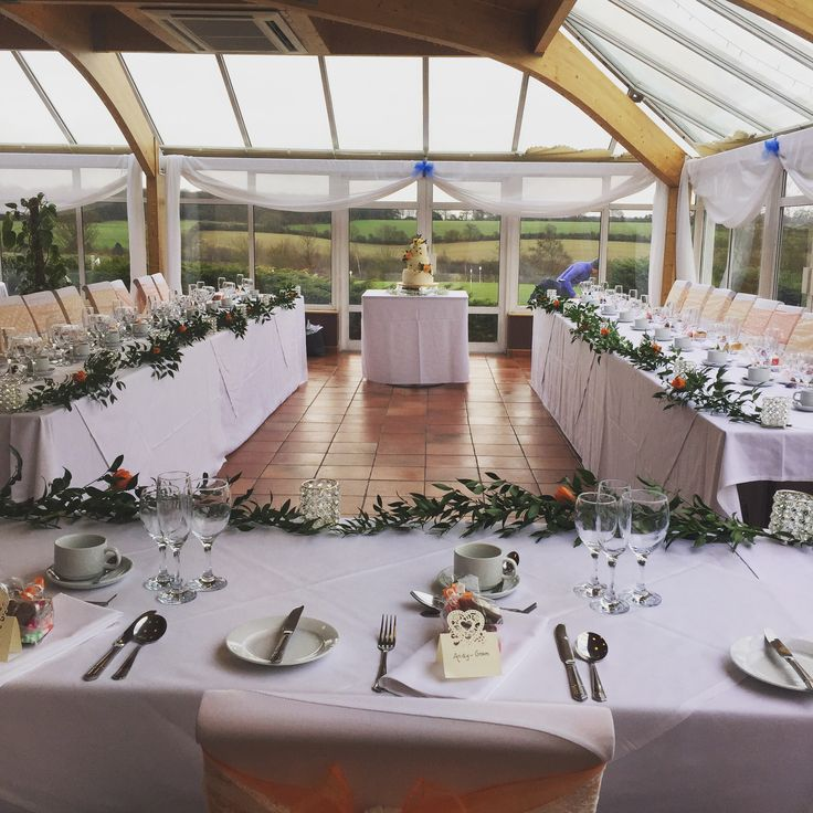 Long tables for Chesfield downs golf club wedding by Amber wedding www.amberweddings.co.uk #amberweddings #flowers #brides flowers #ivory wedding flowers #wedding flowers #Ivory roses #country style wedding #Chesfielddowns #chesfield downs golf #Hertfordshire #bedfordshire #orange # long tables