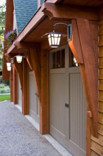 Keep lanterns in mind when house is re-sided, like the lanterns on the corbels by the garage.