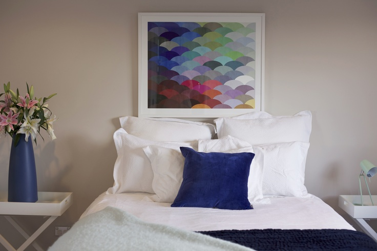 Brighten a neutrally painted room with art print #collected. Tall blue vase #BoConcept. Blue velvet cushion #Citta. Mint green Z lamp to match the owners own Mint green wollen bed throw.