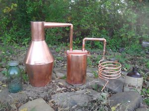 Copper pot still with thumber setup (missing the water barrel to hold the condenser coil).