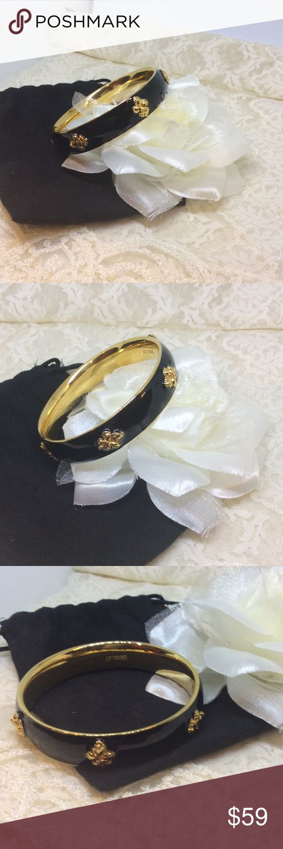 Roberto Cavalli Fleur Black Bracelet Bangle $200 Brand new bracelet!! It's black & gold. Comes with a free sample perfume and the little dust bag. Black with gold fleurs and gold lining on inside. Look at our other items for bundle savings! Just Cavalli Jewelry Bracelets