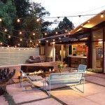 Courtyard lighting ideas patio midcentury with sliding glass doors string lights