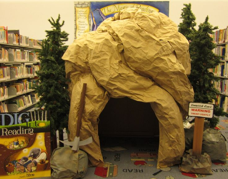 Summer reading display. Look what a combination of a refrigerator box, newspaper, book packing paper and a bunch of staples and glue can become! The kids all loved it. Soon it will become a haunted cave for Halloween, then I will cover it in white paper for a winter igloo.