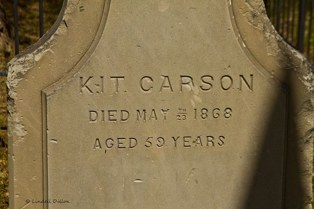 Kit Carson's tombstone  This famous Indian fighter, scout, trapper and army officer is buried in a little cemetery in the Taos, NM city park...