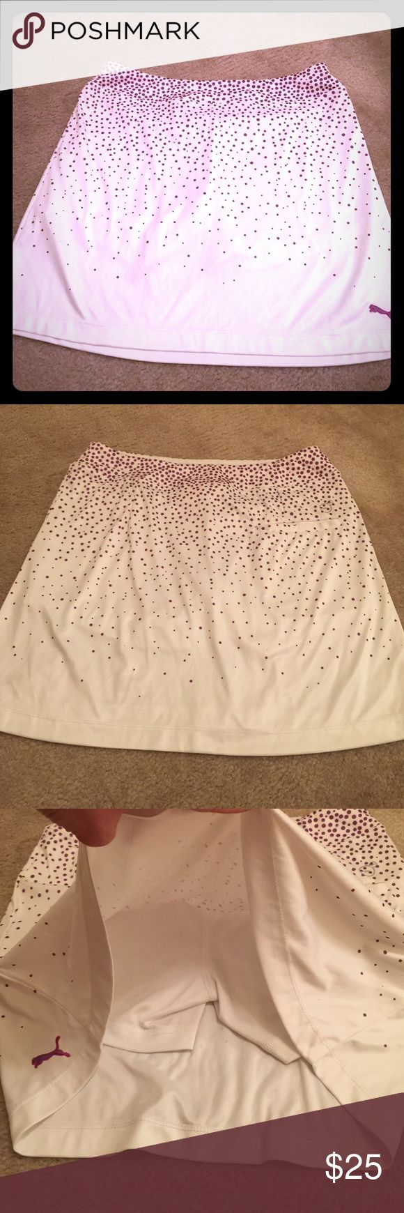 Puma golf skirt Golf skirt with built in shorts. Mostly white with purple dot design. 100% polyester. One pocket on the right butt cheek. Great condition, like new! Puma Skirts Midi