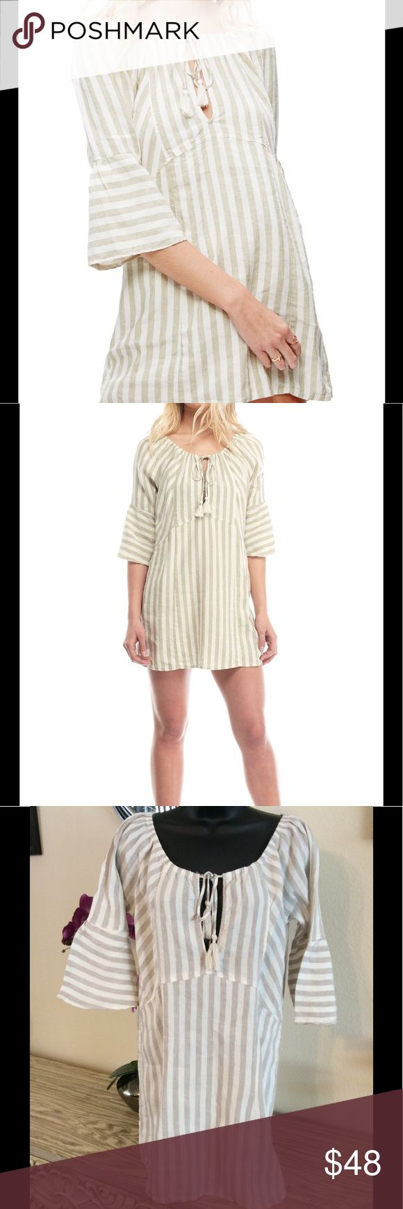 """Free People Striped Linen Dress Cute tan and cream beach style dress. Linen and rayon Blend. Ties at neckline. 19"""" from armpit to armpit and 30"""" long. No stains or big rips. One tiny snag shown in last pic. Could be fixed with a little stitch or patch. Free People Dresses Mini"""