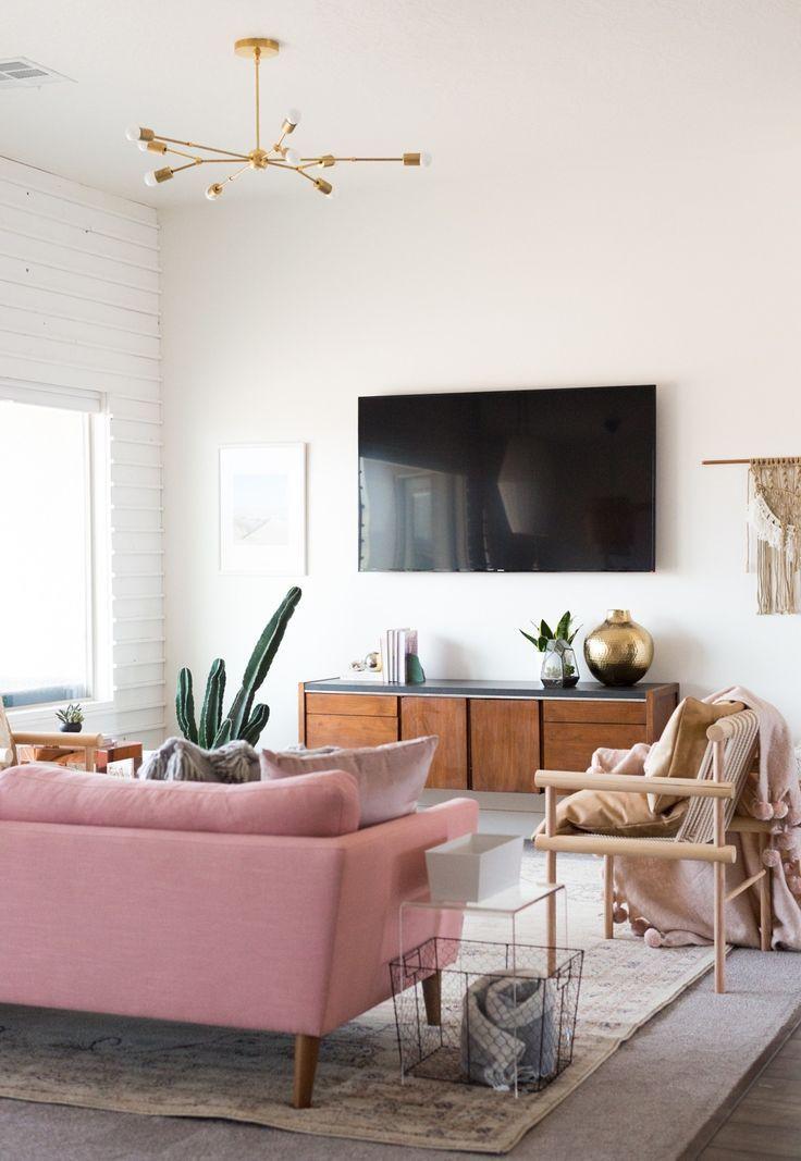 Midcentury inspired living room design with plenty of brass and pops of pink | Boho Scandinavian Living Room Ideas
