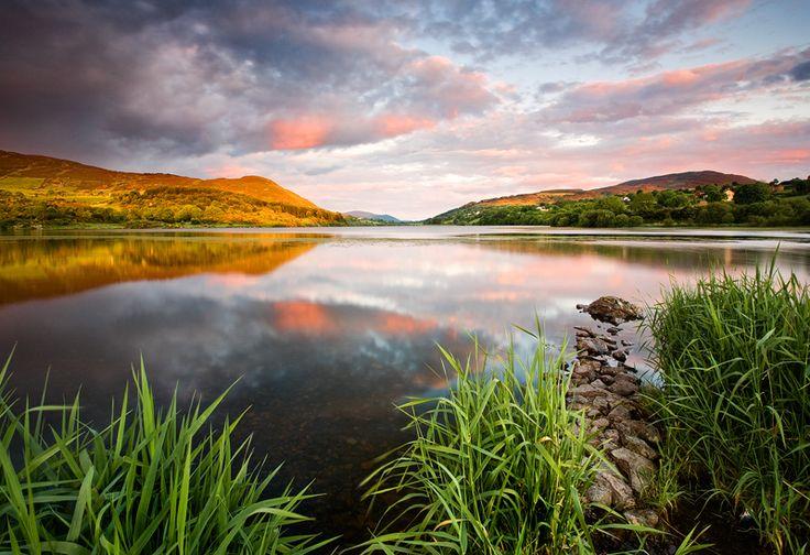 Warm evening light at a calm Camlough Lake.