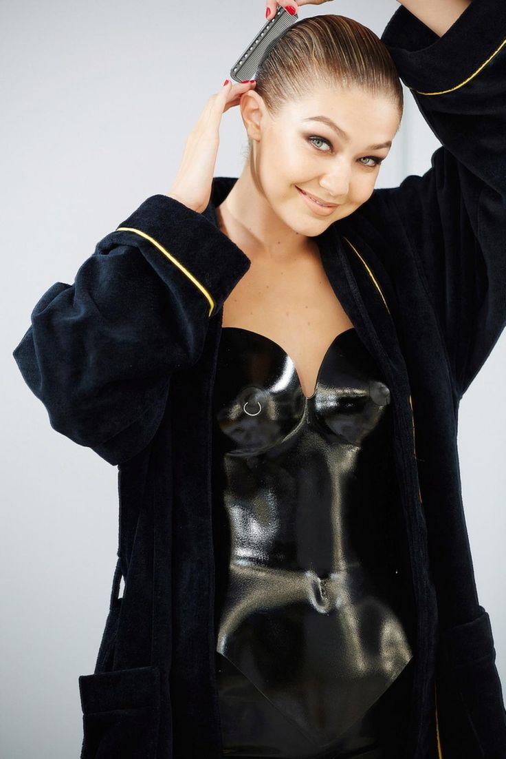 """Recognize this face? That's because she's the daughter of """"Real Housewives of Beverly Hills"""" and former model, Yolanda Foster. Getting ready backstage, newcomer 19-year-old Gigi Hadid poses as Miss November in a cat-woman black corset."""