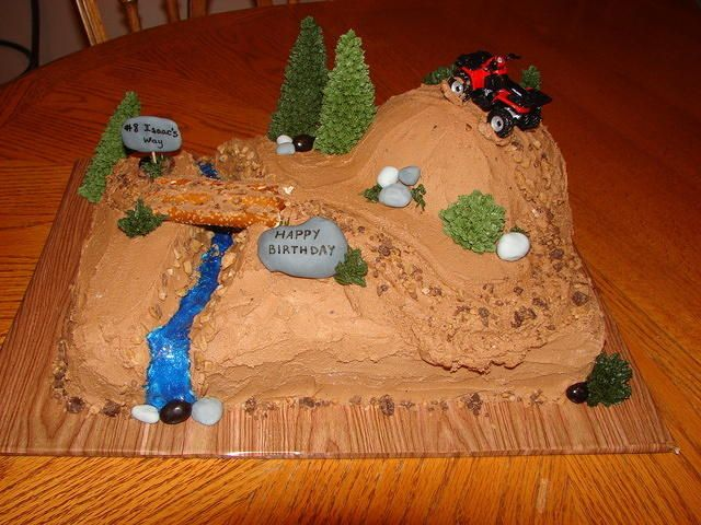 4-wheeler cake made using a 9x13 sheet pan and a small round cake to make the hill. Serves 20