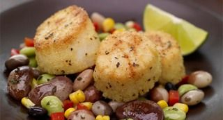 Cornmeal Crusted Scallops with Heirloom Bean and Oregano Succotash: Aromatic oregano perfectly complements the nutty, earthy flavor of heirloom black beans and lima beans in this succotash. It serves as a colorful accompaniment to cornmeal crusted scallops.