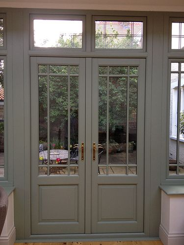 Hardwood French doors... bit different... or should I go traditional 8 glass panels?