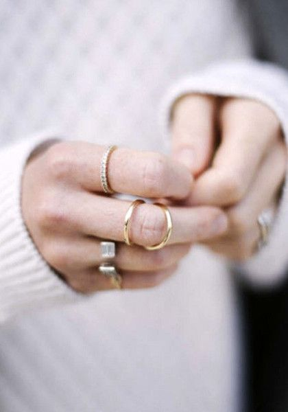 This gold double loop ring will give you another reason to show off your well-manicured hands.
