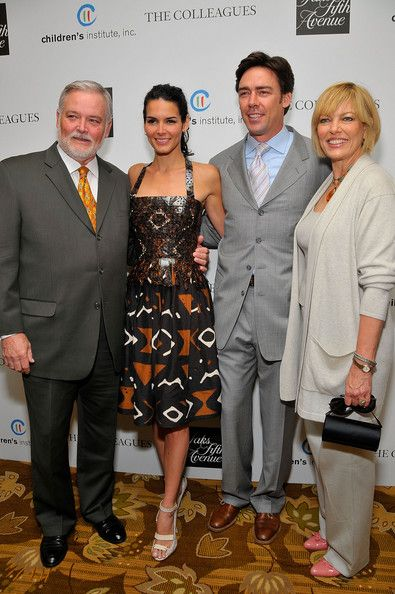 Angie Harmon with her dad Lawrence Paul Harmon (L), her ex Jason Sehorn and her step mom
