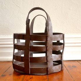 Make a simple, bold statement with this DIY leather basket. Includes an easy to …