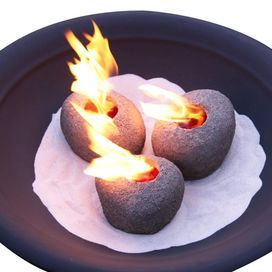 """Hand-painted indoor/outdoor fire rock.   Product: Set of 3 fire rocks Construction Material: Cast iron Color: Natural  Features: For use in existing indoor or outdoor fireplaces or fire pits  Uses real flame gel fuel - not included    Dimensions: 4.5"""" H x 7.5"""" Diameter each"""