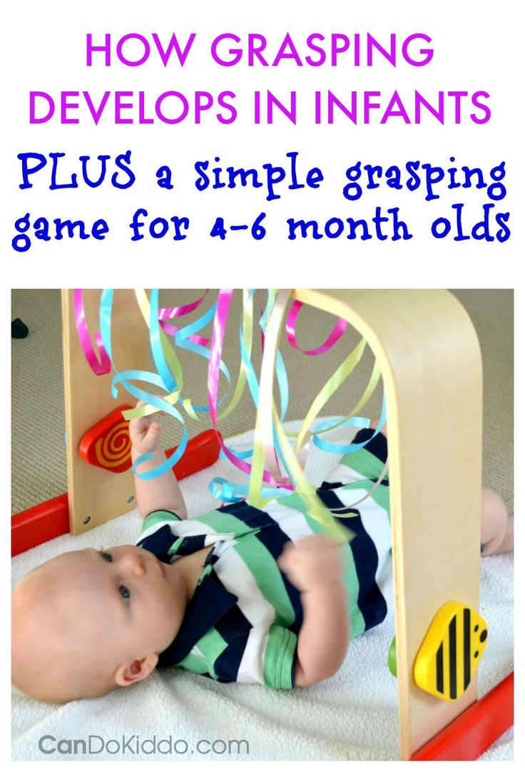 Grasping Play for Babies - an easy baby activity gym game to capitalize on your 4 to 6 month old baby's interest in grasping - PLUS a look at how your baby develops grasping skills from a pediatric Occupational Therapist. CanDoKiddo.com
