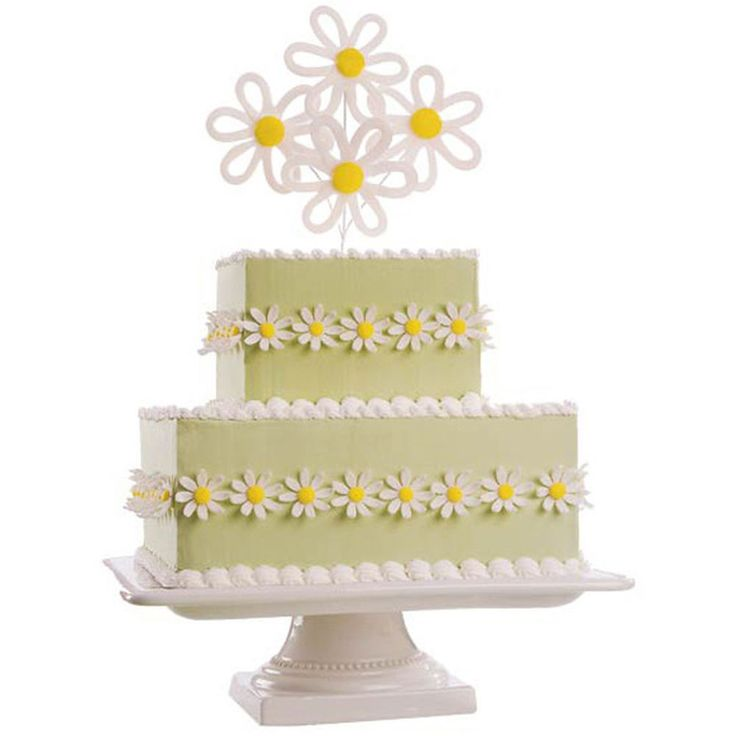It?s the elegant simplicity of daisies that makes this the perfect cake for a spring or summer wedding or shower. Beautiful fondant blossoms rim the cakes sides and top it with a bountiful, vibrant bouquet.