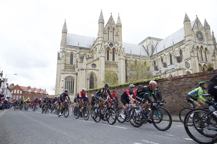 The peloton race past Beverley Minster on stage 2