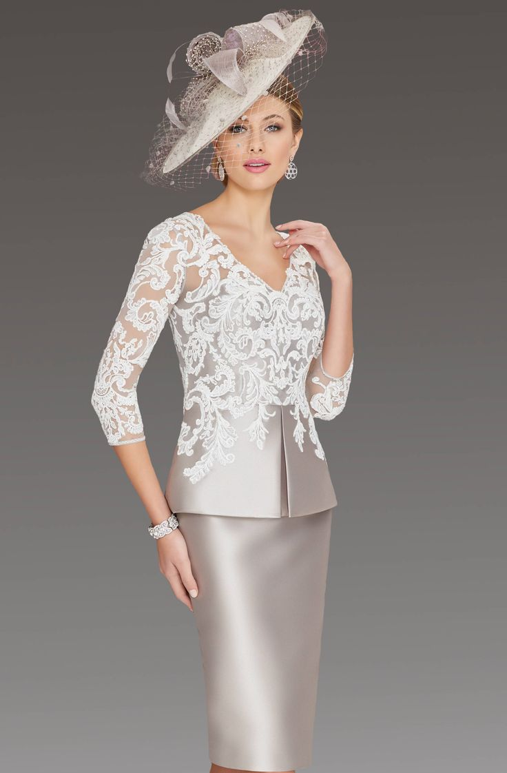 This short fitted dress features a lace bodice with elbow length lace sleeves. Colour: Taupe/ivory