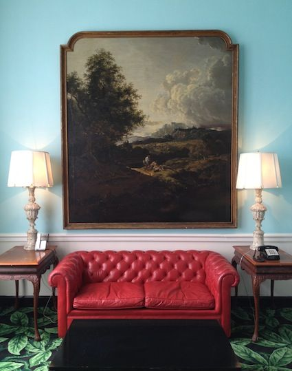 Turquoise Walls With A Red Leather Sofa