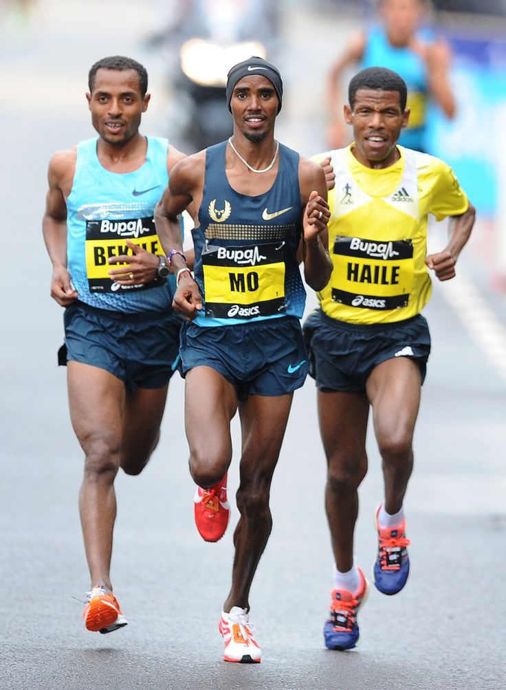 Kenenisa Bekele (L), Haile Gebrselassie (R) and Mo Farah race during the Great North Run on September 15, 2013 in Gateshead, England.