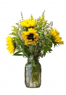 A flower arrangement with sunflowers and goldenrod Stock Photo: Sunflowers And Goldenrod, Sunflower Arrangements, Goldenrod Stock, Floral Arrangements, Indoor Flowers