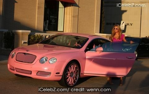 Paris Hilton dressed in pink arrives at Barney's Of New York in her pink Bentley http://www.icelebz.com/events/paris_hilton_dressed_in_pink_arrives_at_barney_s_of_new_york_in_her_pink_bentley/photo1.html