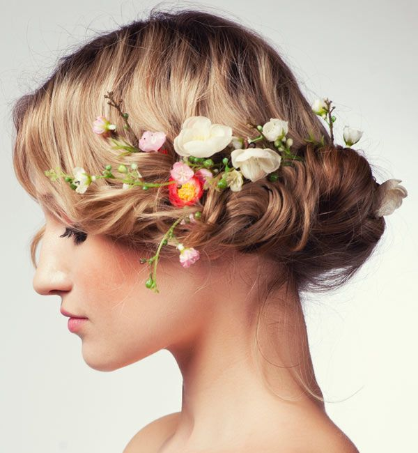 Gorgeous Gibson tuck updo embellished with flowers
