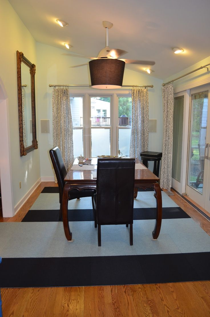 Minimalist White Themed Dining Room Inspirations With Simple Brown Wood Table And Elegant Black Chairs