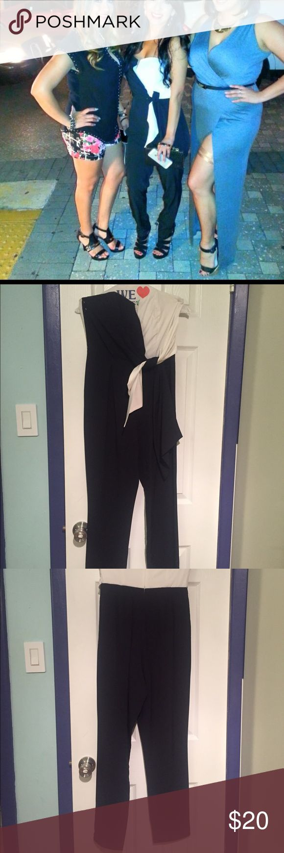Black and white jumper outfit Black and white pant romper. Only worn once, shown in the middle picture. Perfect condition Pants Jumpsuits & Rompers