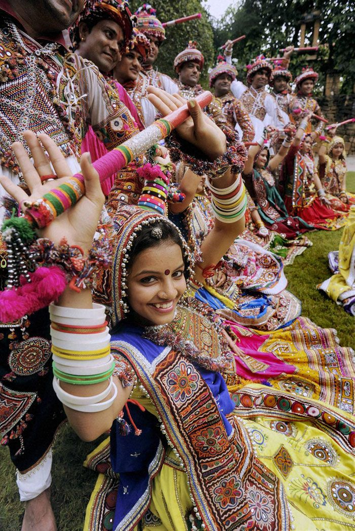 Women dressed in traditional finery carry religious symbols on their heads as they practice the Garba dance ahead of the Navratri festival in Ahmedabad. (