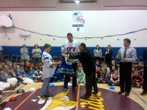 Mayor Cormier presents city jersey to Alex Allain of Nelson Rural School and visiting New England Patriot Rob Gronkowski