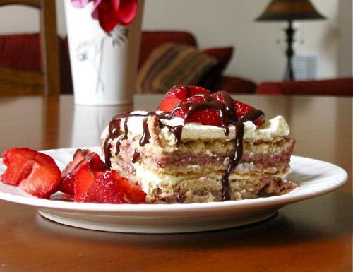 Strawberry Icebox Cake Recipe - Fun fresh alternative to traditional Easter desserts. It's a no bake cake made with graham crackers, pudding and strawberries.
