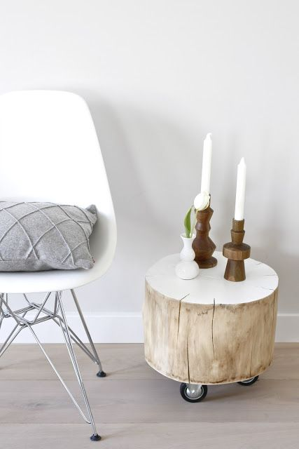 eames dsr, grey pillow, tree trunk on wheels for a side table