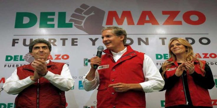 """Top News: """"MEXICO POLITICS: PRI Likely to Win Election"""" - http://politicoscope.com/wp-content/uploads/2017/06/Governor-candidate-Alfredo-del-Mazo-C-of-the-Institutional-Revolutionary-Party-PRI-delivers-a-message-to-the-media-next-to-his-wife-Fernanda-Castillo-R.jpg - An early count from the State of Mexico's electoral institute projected PRI candidate Alfredo del Mazo as winning between 32.75 percent and 33.59 percent of the vote.  on Politics - http://politicoscope.com/2017/"""
